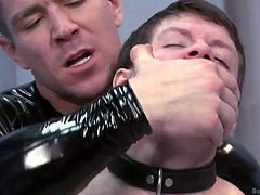 With his hands and feet chained, Tyler doesn't has many options left, but to bent over, and take it like a man. His sexy executor grabs him by the hair, bends him over, as hard as possible and shovels his cock deep in his ass. His big, thick dick rips Tyler's anus and makes him moan like a whore!