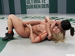 Sexy bitches Mellanie Monroe and Wenona struggle with each other on tatami and get horny. Then they pet one another and have doggy style sex.