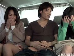 Two Japanese girls have fun in the car. One of them gives a handjob and a blowjob. The other one watches and gets her pussy fondled.