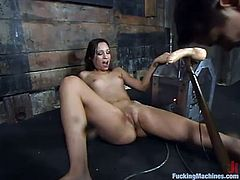 Lustful brunette Amber Rayne is having fun with a fucking machine in a basement. She takes the device in her snatch and gets it pounded like never before.