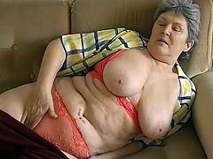 Chunky old day with grey hair lies on the couch exposing her big juggs and her flabby ass. Old hussy sucks metal vibrator and sticks it into her snapper.