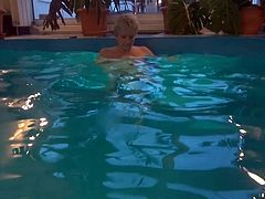 An old granny masturbating in the swimming pool