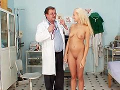 Angel and her doctor are playing with toys
