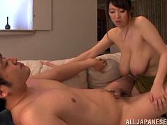 Hot Japanese mom Mio Sakuragi licks and rubs her man's dick. Then she takes it in between her boobs and massages it till it explodes with cum.