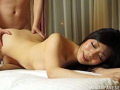 Cute Japanese MILF gives a handjob and fucks in a bedroom