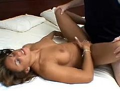 Sexy brown-haired milf is having fun with a lucky dude in a bedroom. She sucks and rubs his prick and then they fuck in cowgirl and missionary positions.