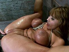 Hot chick lies on a wooden chest being tied up. Her Master whips her ass and fingers the pussy. Later on she also gets toyed deep in her tight ass.