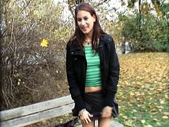 Watch this young brunette sweet babe with nice round tits and big nipple in this outdoor video, where you will see her sucking a huge cock on her knees and getting hard pounding behind the trees in the garden.