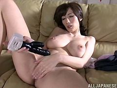 This Japanese cutie is incredibly horny and she's sticking dildos and vibrators in her dripping wet pussy, check it out!