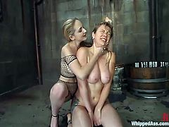 Long-haired blonde Chanta-Rose is playing BDSM games with lustful chick Adrianna Nicole. Chanta binds Adrianna, beats her with a lash, then drowns the slave and smashes her pussy with a strapon.
