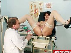 Brunette cougar Radima gets her pussy and asshole stretched by her doctor. That mature freak stuffs her ass with a ball on a leash and stretches her pussy!
