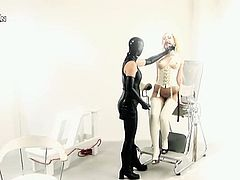 It's weird kinky dmination lesbian sex with a girl in latex dominating the blonde, fingering her, using a sybian to make her cum and forcing her to lick her ass.