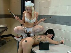 Bent over the desk and with her hands tied, Tori is being sexually exploited by mistress Lee. Lee wears her kinky nurse costume and wires Tori, before playing with her ass. She putted electrodes on her sexy butt, spanked her and then, inserted a metal stick in her pussy. Let's see, if she's gonna turn on the power!