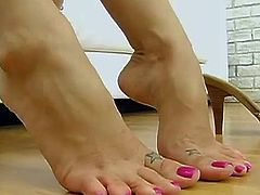Check out this hot scene where this sexy brunette shows off her amazing foot giving talent. Watch her giving this guy a footjob until he cums all over them right after teasing him with her sexy body.