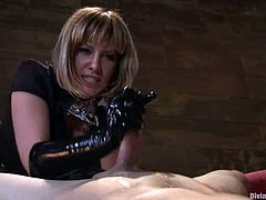 Blonde mistress Maitresse Madeline is having fun with John Jammen in a basement. The dominatrix hurts the stud and then sits down on his face and makes him lick her shaved cunt.