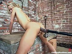 Nice blonde babe have some fun in a building under construction. She gets her juicy vagina and tight ass stuffed by the fucking machine.
