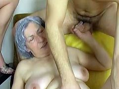 Chunky granny with big fat belly takes part in FFM scene. Old saggy tittied bitch gives blowjob sucking young cock and gets her flabby snatch drilled doggystyle.