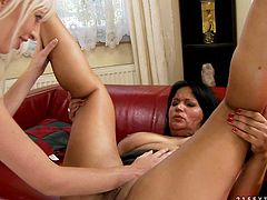 Two kinky blonde and brunette lesbians go wild on camera. BBW black haired mommy gets her wet shaved cunt licked and brutally finger fucked.