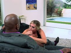 Samantha Saint is getting her mouth fucked by a large black cock