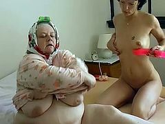 Filthy SSBBW grey haired granny shares her sex toys with one skinny ugly MILF. Skanky mature whores poke each other's stinky twats with big dildos.