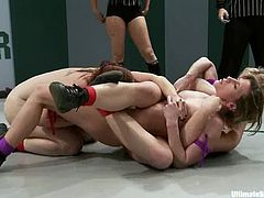 Two passionate redhead chicks wrestle in a ring in public. Then the losing girl gets her vagina fingered hard and deep.