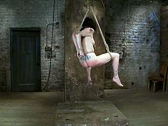 Ropes are used to hang Scarlet Faux from the ground, making her suspended from the ceiling in a hot naked way.