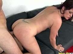 Tattooed brunette gets fucked hard by rapacious dude on the black couch. He fingers her pussy and makes her cum. Then he bumps her in doggy style position in steamy Reality Kings sex clip!
