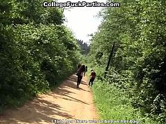 A bunch of college students are chilling at the picnic at the country place. Two dirty sluts give double blowjob by the riverside. Later on they have passionate lesbian sex involving big sex toy.