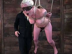 Captivating blonde Lorelei Lee is having fun with some guy in an underground. The dude hangs Lorelei up and drills her smooth pussy with a dildo.