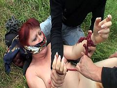 This old woman was followed by two horny young dudes. They immobilized her and shoved their cocks in her throat and in her hairy snatch. They came on her face and left.