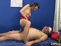 Santa worked hard and now he deserves a present. Why not Santa receive a present too? And what a present! Chelsy is Santa's special present and she bends over in front of him to get fucked. Santa drills her pussy really hard and deep, ravishing this chick! She's covered in piss but will she be covered in semen too?