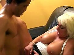 Busty milf Dana Hayes is having fun with some guy indoors. She allows him to rub her meaty vag and then they fuck in side-by-side and the reverse cowgirl position.
