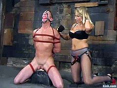 Plew gets tied up and whipped by his blonde mistress. This kinky woman destroys his ass with the strap-on.