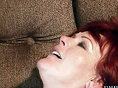 Redhead lets guy stick his thick pole in her mouth