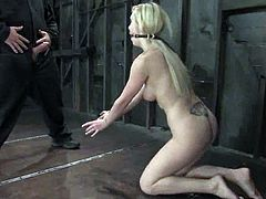 Tied up blondie gets her tits twisted and clothespinned. Later on she gets her wet vagina fingered and toyed.