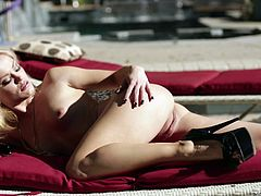 Press play on this breath taking solo scene where a gorgeous blonde babe gives you a boner as she takes off her clothes by the pool to soak up on the sun.