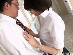 Salacious office girl Airi Suzumura is playing dirty games with some guy in CFNM scene. She pets the dude and then kneels in front of him and sucks his dick greedily.