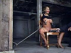 Blonde chick with huge boobs gets tied up and clothespinned. After that she also gets with a vibrator in a basement.