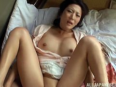 Hot video of a Japanese milf  getting fucked doggy style