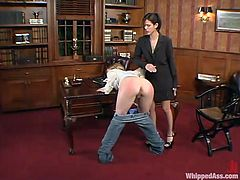 Poor Anna Mills gets her nice ass spanked by Shy Love in the office. Then Anna licks Shy's vagina and gets toyed with glass dildo.