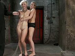 Blonde bitch gets tied up and then whipped by some guy. After that she gets pounded from behind by another girl with the strap-on.