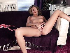 Lucy Blackburn with small tities and bald pussy does her best to get you hot in solo action