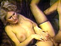 Eye catching blonde hussy in negligee and black stockings is happy to blow two dicks in MMF threesome. Blonde beauty gets shagged in missionary and doggy poses.