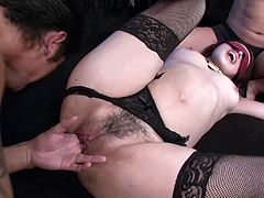 Naughty brunette chick Ann Yabuki sexually pleased by two perverted Asian dudes. One is holding her hands while the other licks and fingers her clam. Ann is moaning seductively enjoying the action.