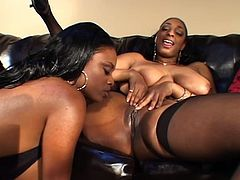 Two petite ebony chicks are pleasing each other so hard