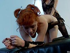 Submissive redhead electroslut gets bound by Gia Dimarco. Then Audrey gets her ass hot with electricity and stuffed with big dildo.