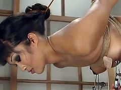 Mika Tan gets bound by lewd dominatrix Nina. Nina torments Mika and then destroys her Asian cunt with a dildo.