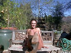 Pretty brunette amateur Olivia Wilder with ponytail and nice natural boobs in thong and leather cowboy boots only gets covered with oil and teases with round eatable ass all over backyard.