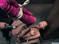 This smoking hot Asian siren is under the BDSM fantasies. She gets tied up and then Derrick sticks his huge cock in the possible holes of Tia Ling.
