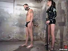 Naughty girl in latex ties the guy up and then fixes a lot of clothespins to his body. After that she drills his ass with a strap-on from behind.